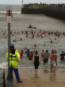 120 brave the chilly waters for the annual West Bay Boxing Day swim