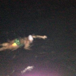 Me swimming at night