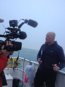 Mike being interviewed by the BBC as we have swam through the night and daylight appears