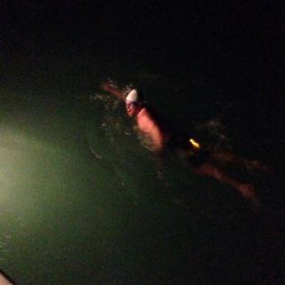 Paul swimming at night
