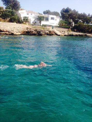 Swimming past the boat